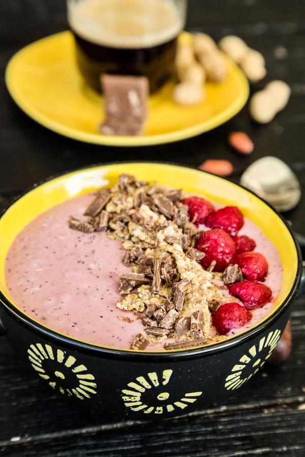 Healthy breakfast. Smoothie bowl with frozen fruits, greek yogurt and cereals royalty free stock images