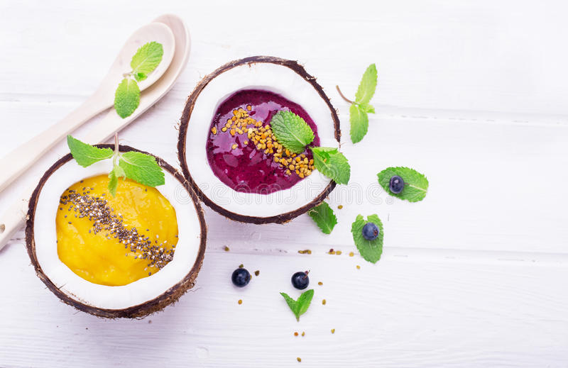 Healthy breakfast smoothie mango and berries royalty free stock photography