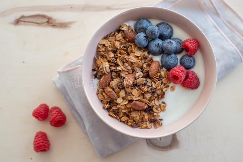 Healthy breakfast super food cereal concept with fresh fruit, granola, yoghurt royalty free stock images