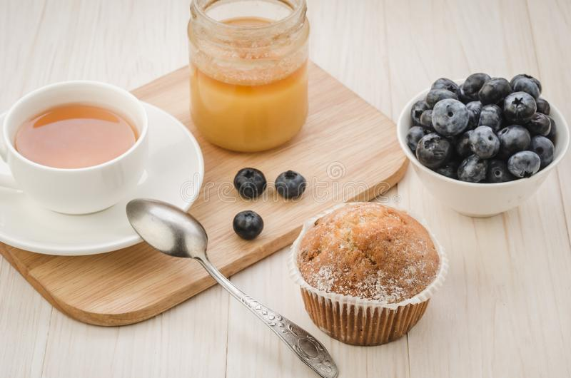 Healthy breakfast: tea with cake, honey and fresh blueberry/healthy breakfast: tea with cake, honey and fresh blueberry on a royalty free stock images