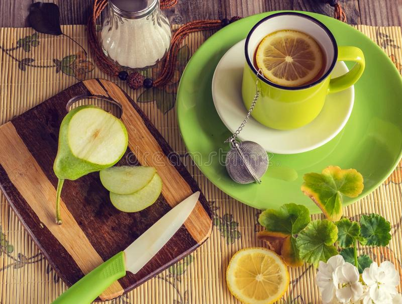 Healthy breakfast. Tea with lemon, sugar and pear. Summer lifestyle royalty free stock images