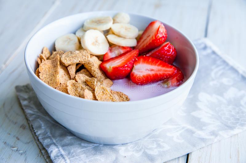 Healthy Breakfast which included cornflakes and oatflakes, yogurt, bananas. And strawberries royalty free stock photo