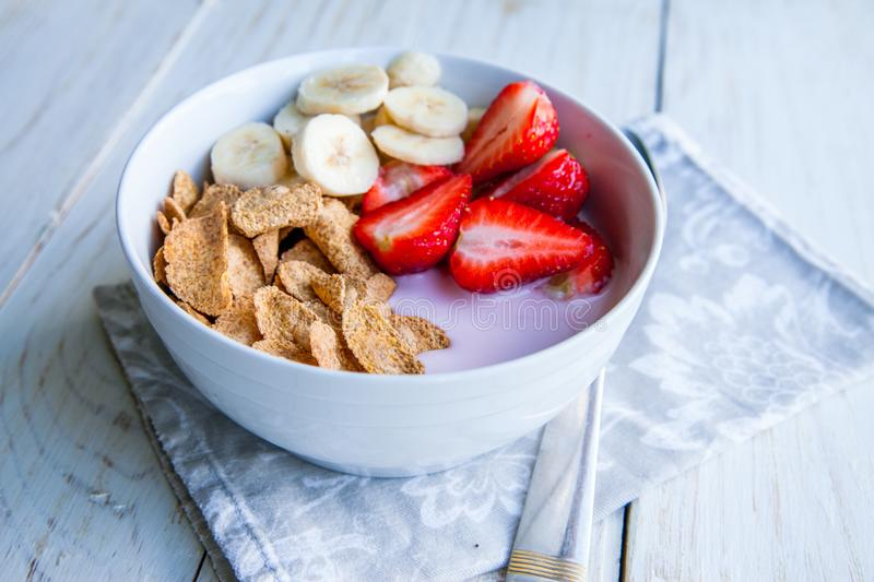 Healthy Breakfast which included cornflakes and oatflakes, yogurt, bananas. And strawberries royalty free stock images