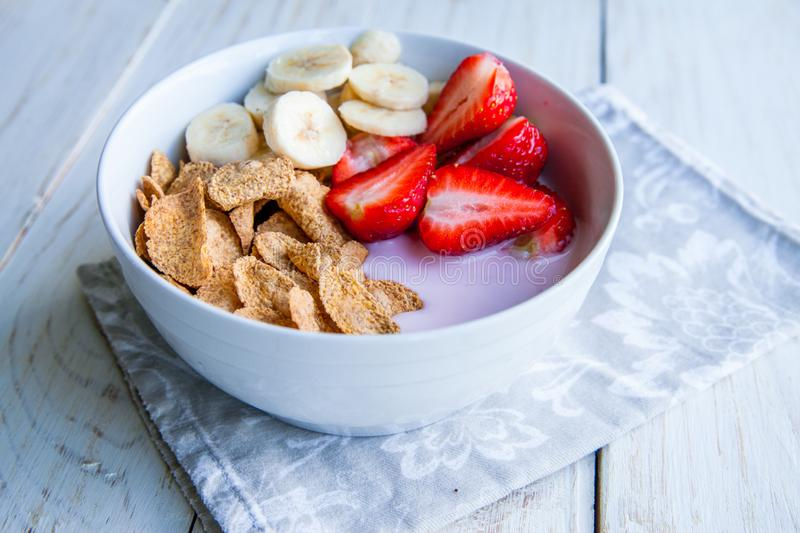 Healthy Breakfast which included cornflakes and oatflakes, yogurt, bananas. And strawberries royalty free stock photos