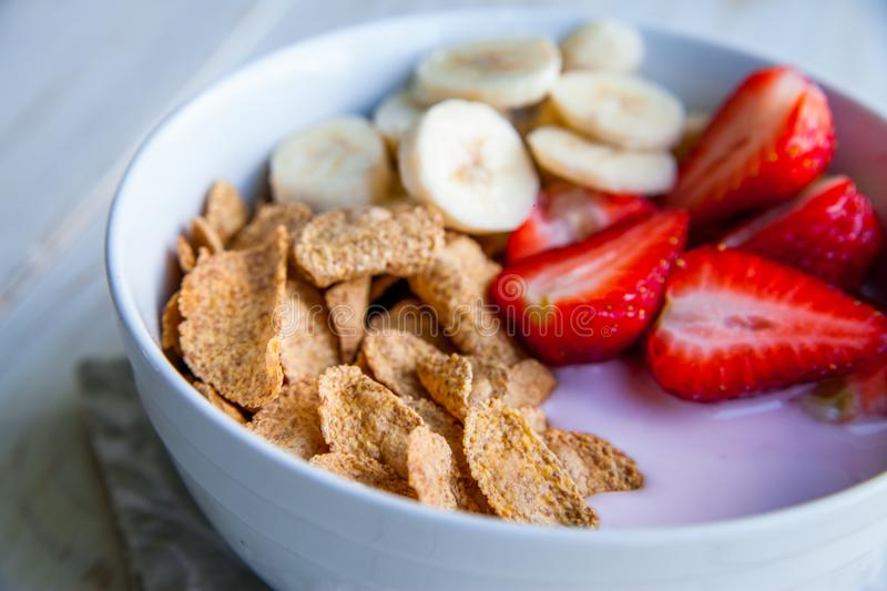 Healthy Breakfast which included cornflakes and oatflakes, yogurt, bananas. And strawberries royalty free stock photography