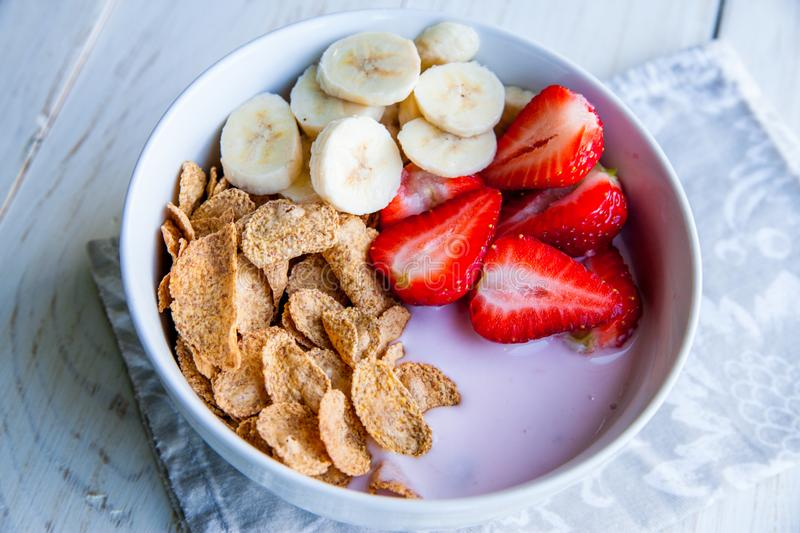 Healthy Breakfast which included cornflakes and oatflakes, yogurt, bananas. And strawberries stock image