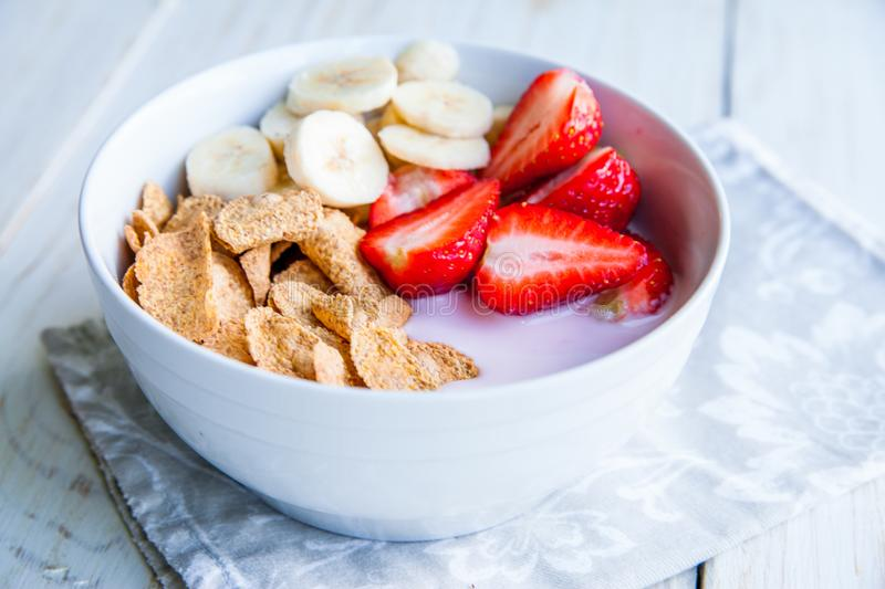 Healthy Breakfast which included cornflakes and oatflakes, yogurt, bananas. And strawberries stock photo