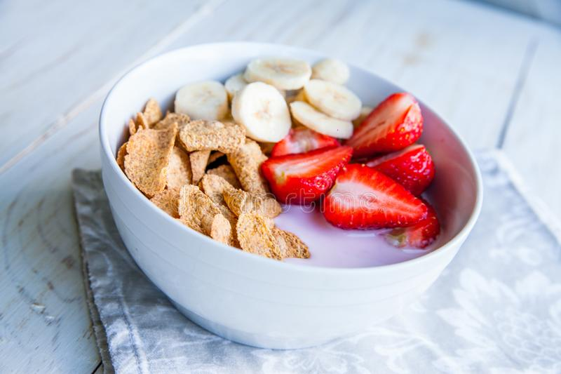Healthy Breakfast which included cornflakes and oatflakes, yogurt, bananas. And strawberries royalty free stock image