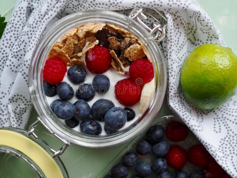Healthy breakfast yoghurt with corn flakes and fruits royalty free stock photos