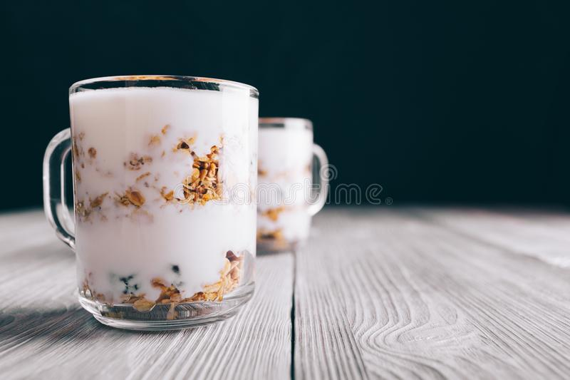 Healthy breakfast with yogurt in glass cups. On a table close-up stock photos