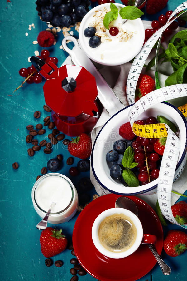 Healthy breakfast - yogurt with muesli and berries - health and. Diet concept. Blue background royalty free stock photography