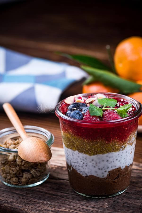 Healthy brunch with fruits and granola, served in jar royalty free stock photos