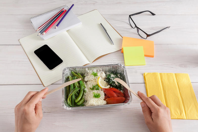 Healthy business lunch snack in office, vegetable salad pov view royalty free stock photography
