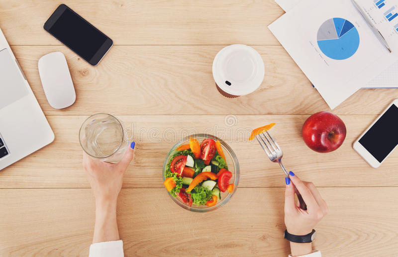 Healthy business lunch for woman, top view at table. royalty free stock photo