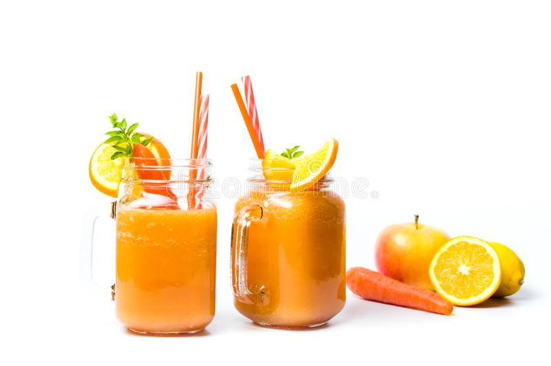 Carrot smoothie in a jar isolated. Healthy carrot and orange smoothie in a jar isolated royalty free stock photography
