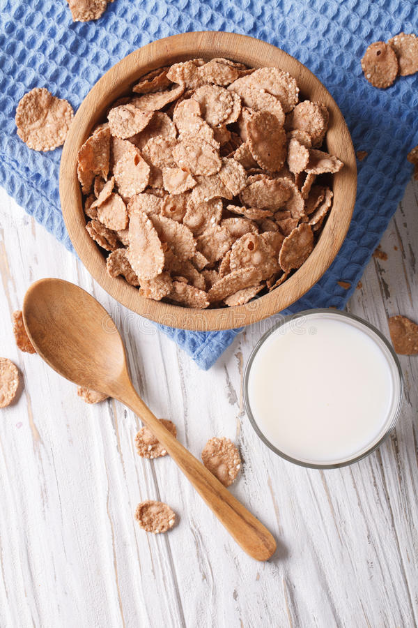 Healthy cereal flakes and milk close-up. vertical top view royalty free stock photos