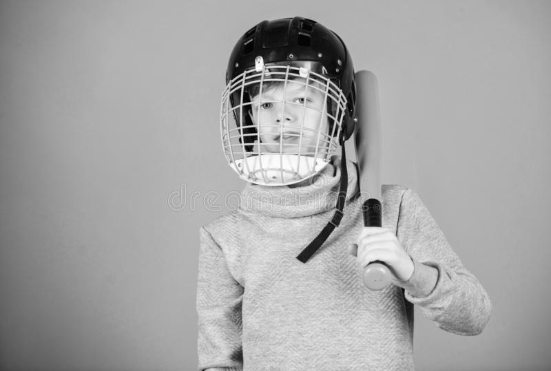 Healthy childhood. Baseball training concept. Boy in helmet hold baseball bat. Sport and hobby. Care about safety. Teenager boy likes baseball game. Active stock photo