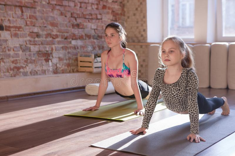 Healthy children lifestyle. Yoga for kids royalty free stock image