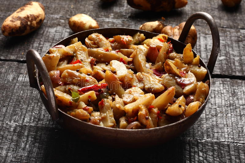 Healthy Chinese potato stir fry. Delicious Chinese potato stir fry in cast iron cookware royalty free stock photos