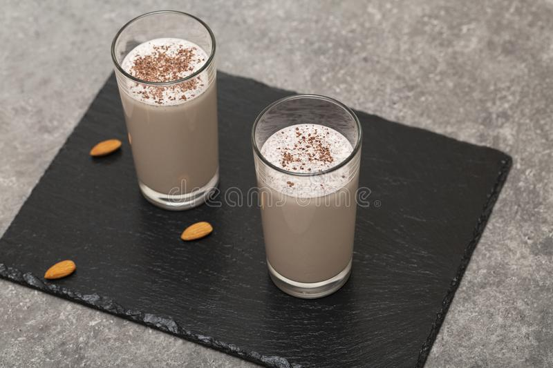 Healthy Chocolate Protein Shake with Almond Milk, banana, chocolate and nuts. Tasty and healthy Breakfast stock photos