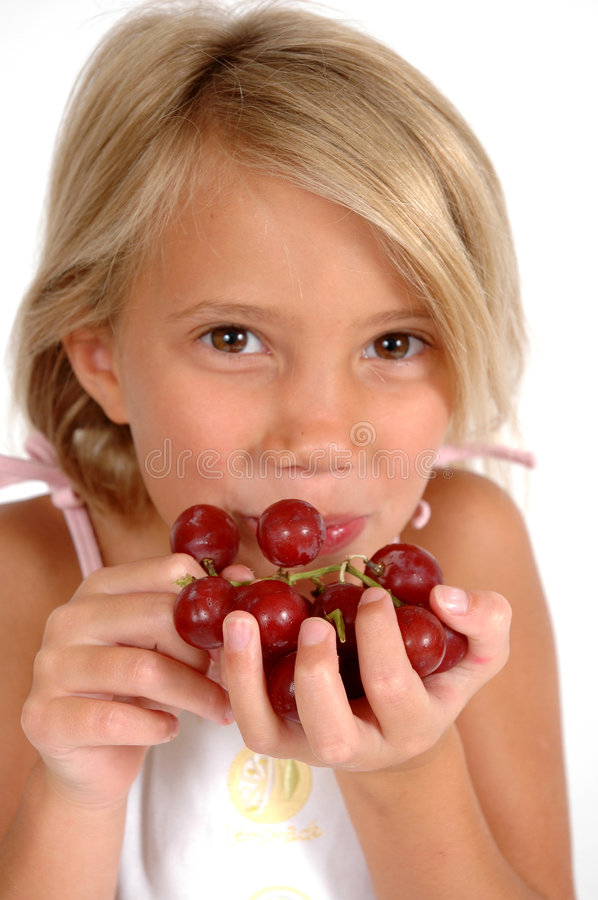 Healthy Choice. Little girl holds out hand to tempt you to eat grapes. Little child hods out healthy food choice royalty free stock images