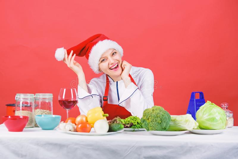 Healthy christmas holiday recipes. Best christmas recipes of perfect housewife. Woman chef santa hat cooking at kitchen royalty free stock images
