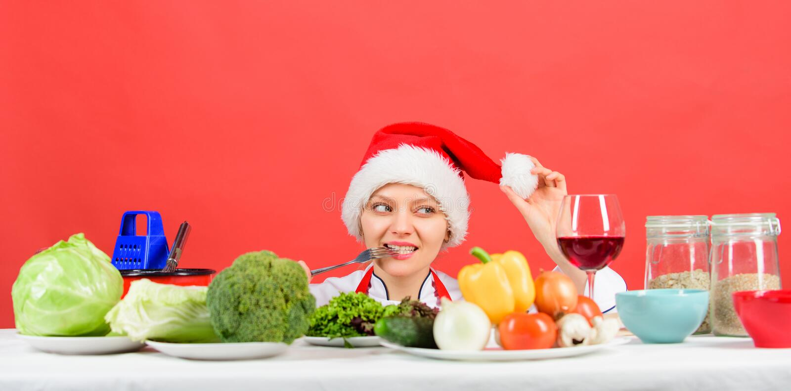 Healthy christmas holiday recipes. Woman chef or housewife cooking while wear santa hat. Best christmas recipes. Festive stock images