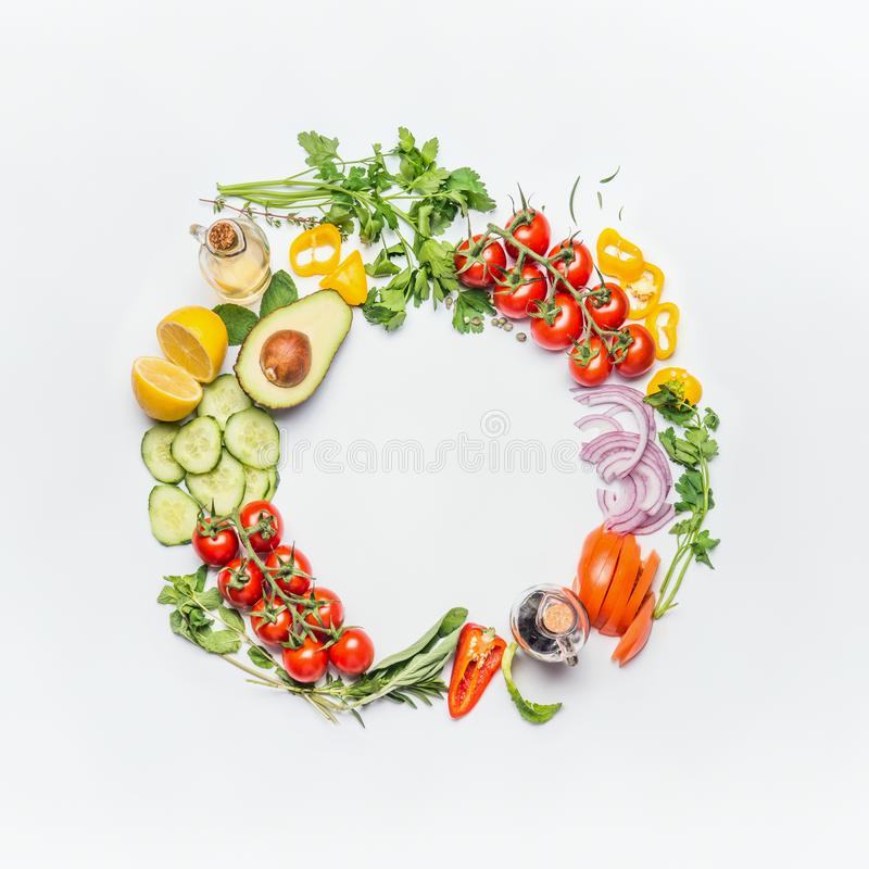Healthy clean eating layout, vegetarian food and diet nutrition concept. Various fresh vegetables ingredients for salad on white. Table background, top view royalty free stock photography