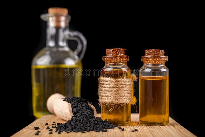 Healthy, cold pressed black cumin oil. Ingredients for a healthy diet in a modern kitchen royalty free stock image