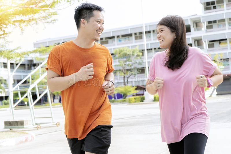 Healthy concept  Men and women who are jogging together happily stock images