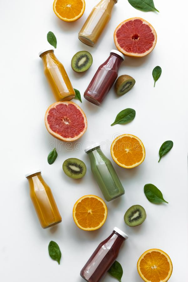 Healthy concept. Oranges, grapefruits and different juices on white background.  stock photo