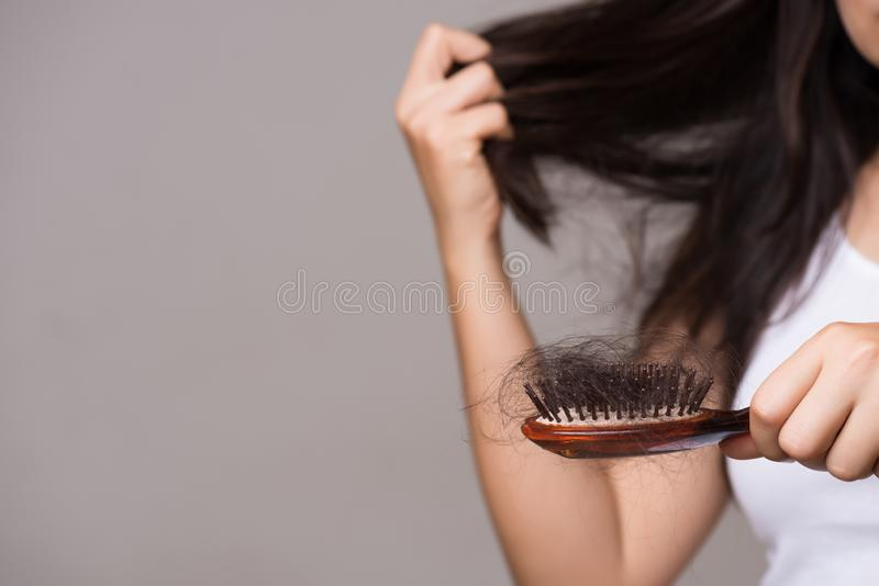 Healthy concept. Woman show her brush with long loss hair and looking at her hair royalty free stock photos