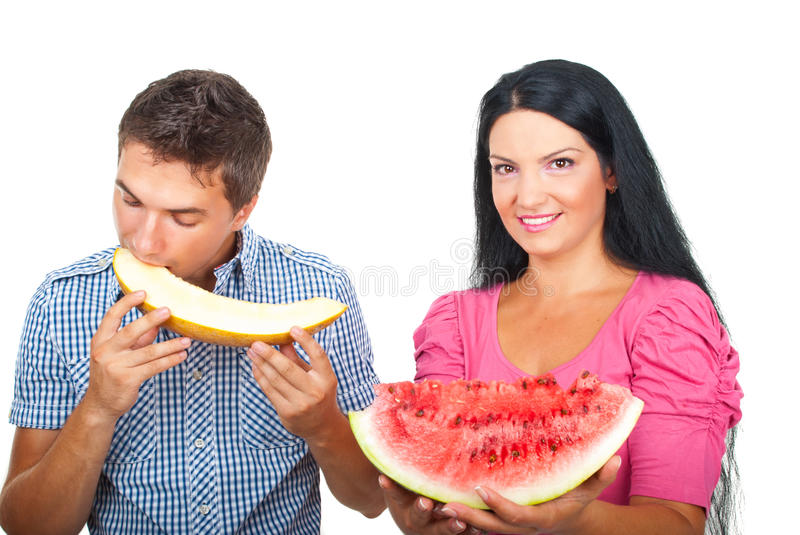 Healthy Couple Eating Melons Royalty Free Stock Image