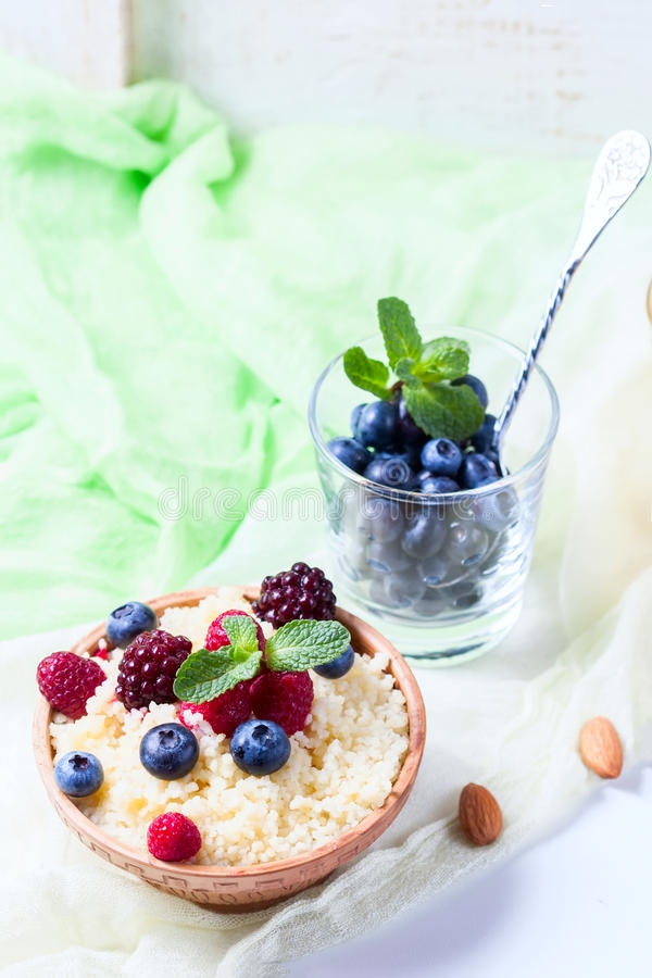 Healthy couscous salad with berries. Selective focus royalty free stock image