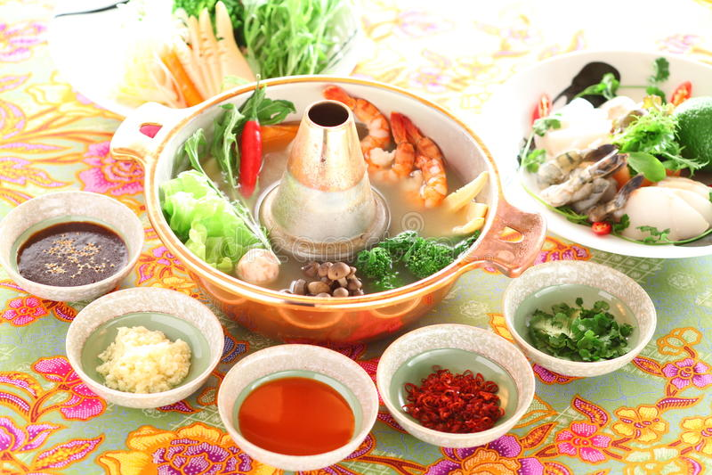 Healthy creative Thai hot pot with shrimp, mushroom, broccoli, o royalty free stock image