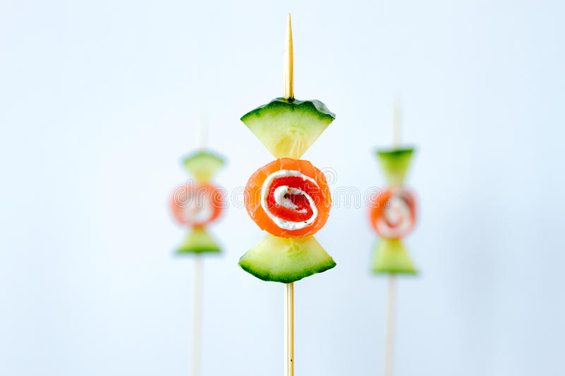 Healthy cucumber smoked salmon snack in creative candy shape royalty free stock image