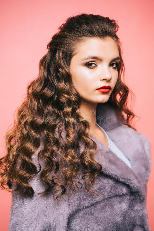 Healthy curls that look bouncy. Hair styling in beauty salon. Teenage girl with stylish wavy hairstyle. Pretty girl with. Curly hairstyle. Young woman with long stock photos