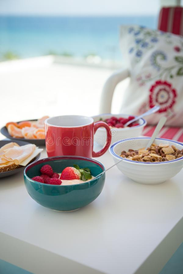 Healthy and delicious breakfast on the balcony with beautiful ocean view. Coffee time. Vacation by the sea. royalty free stock image