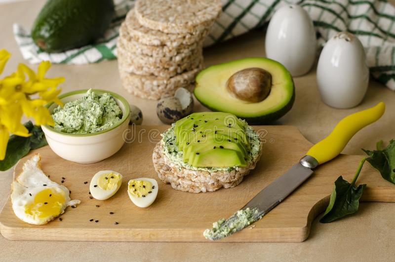 Healthy delicious breakfast or lunch. Buckwheat crispbread with cottage cheese, spinach and avocado. Healthy food and ketogenic diet concept royalty free stock photos