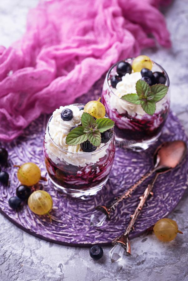 Healthy dessert with berry and cream cheese stock photos