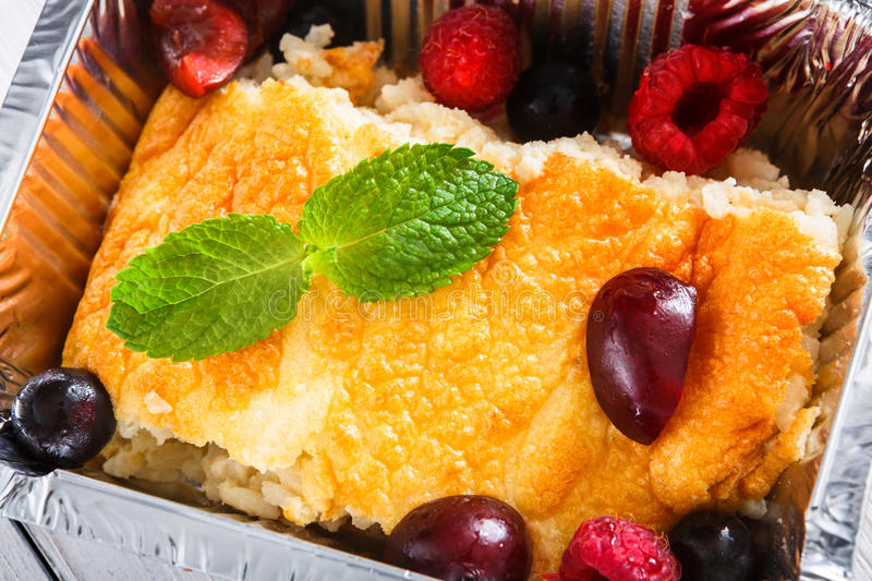 Healthy dessert. Sweet baked rice pudding in foil box stock photos