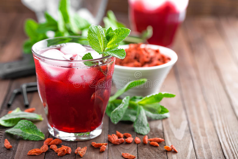 Healthy detox drink with goji berries infused in water with ice, cold refreshing beverage close-up stock photos
