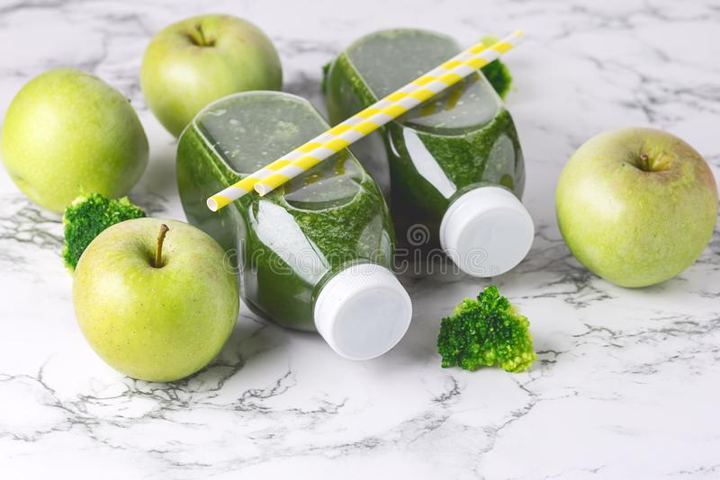 Healthy Detox Green Smoothie with Green Apples and Ripe Broccoli in Bottles Healthy Diet Food Drink Horizontal Toned.  royalty free stock photography