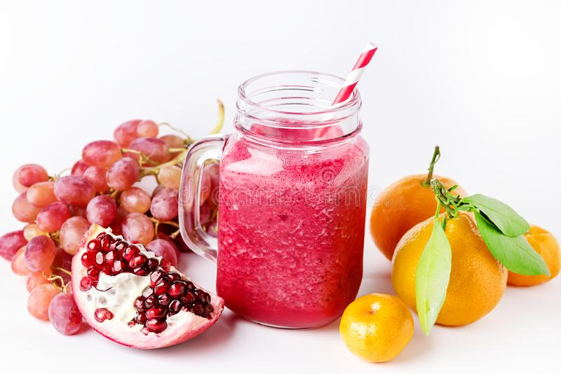 Healthy Detox Smoothies on a White Background With Fruits Citrus Grape Pomegranate Glass Jar of Tasty Smoothie Horizontal royalty free stock image