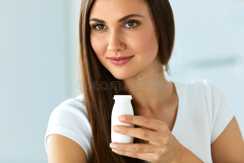 Healthy Diet. Beautiful Smiling Woman Drinking Natural Yoghurt royalty free stock image
