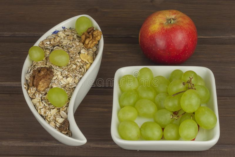 Healthy Diet breakfast of oatmeal, cereal and fruit. Foods full of energy for athletes. The concept of diet food. stock photography