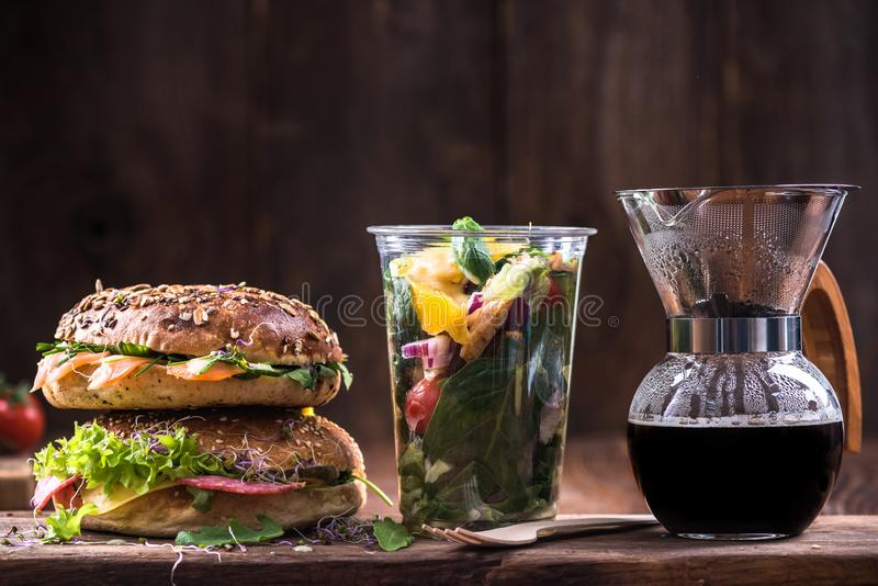 Healthy diet eating,bagels,coffee and salad stock images