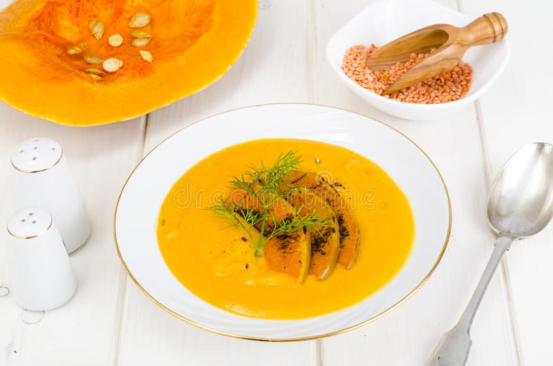 Healthy diet food. Cream soup with lentils and pumpkin royalty free stock photography
