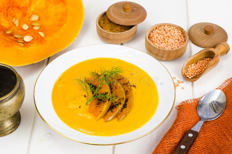 Healthy diet food. Cream soup with lentils and pumpkin royalty free stock images