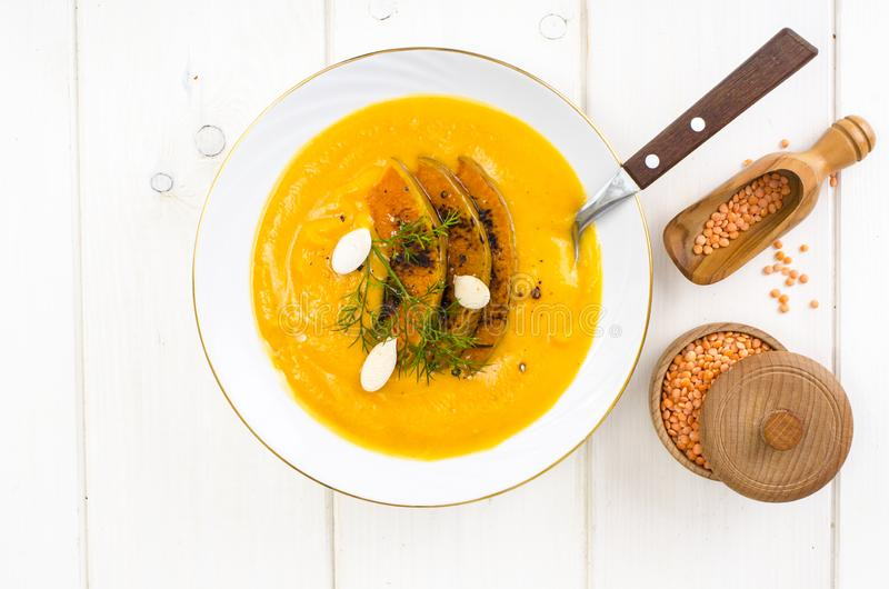 Healthy diet food. Cream soup with lentils and pumpkin royalty free stock image
